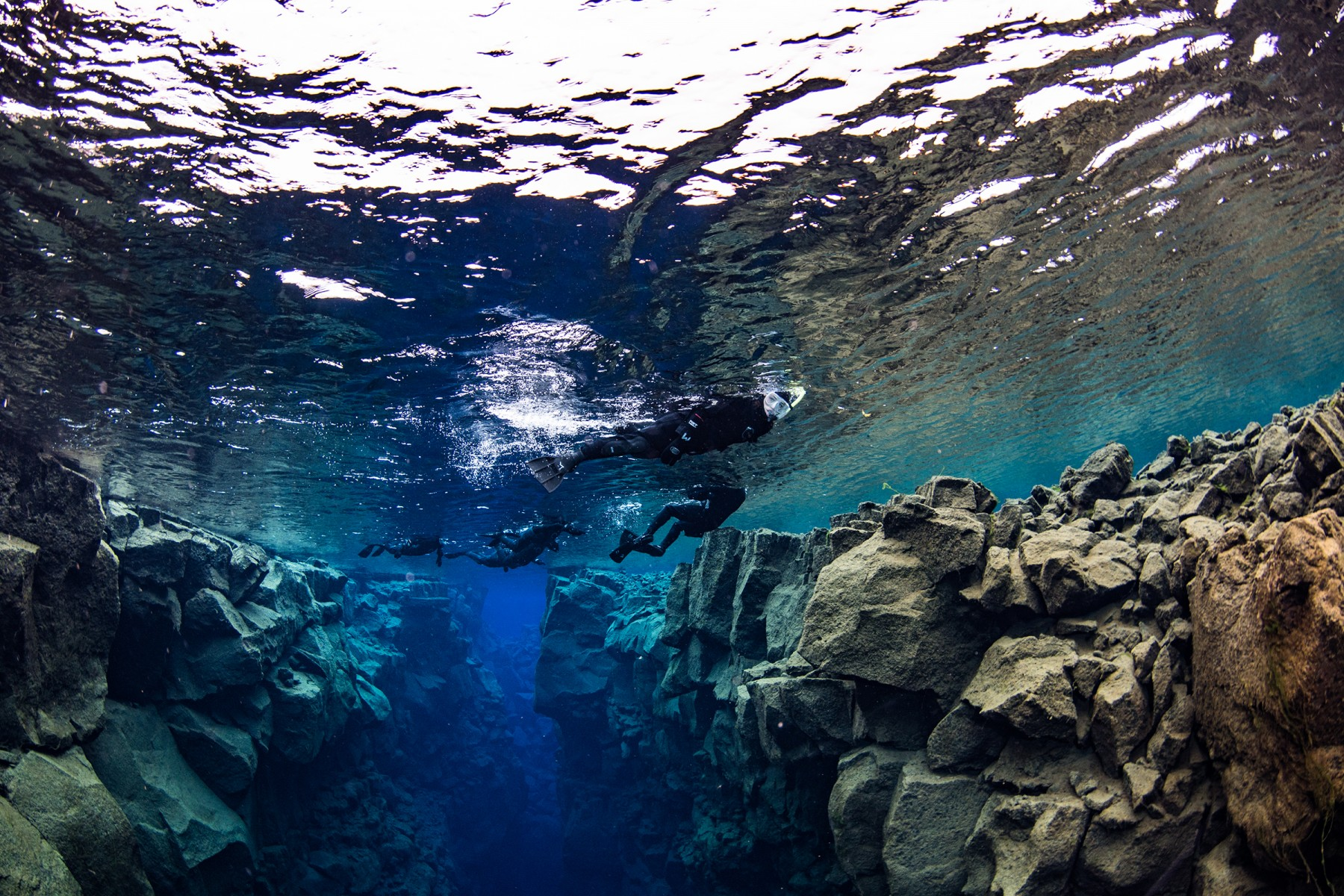 A group snorkeling in Silfra Fissure