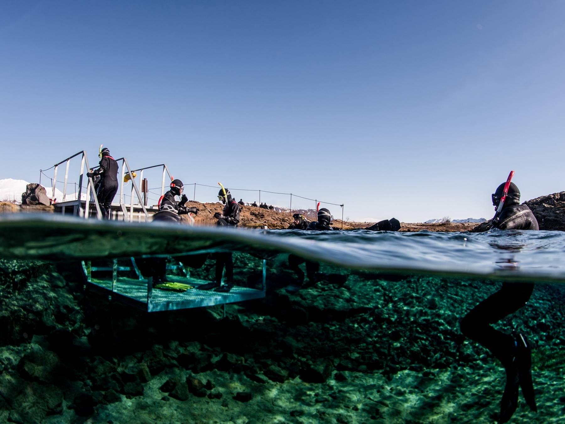 split-view-snorkelers-exiting-platform-silfra-lagoon-anders-nyberg-1800x1200.jpg