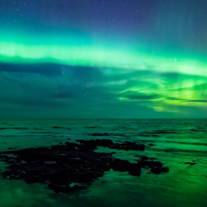 aurora-borealis-over-the-sea-gardur-iceland-psb8x8e-720x720.jpg