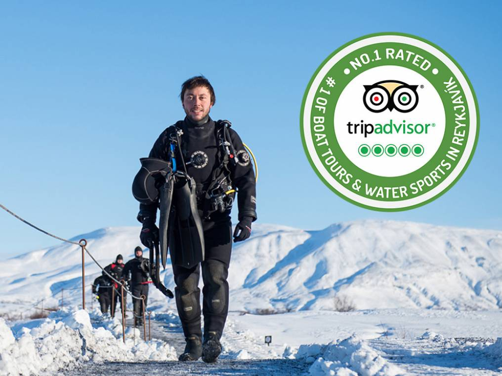 Smiling Dry suit diver next to our TripAdvisor badge