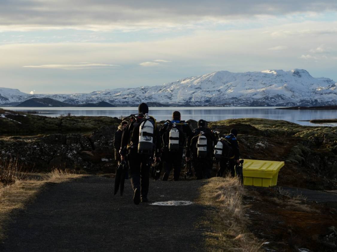 Divers ready in their dry suit gear walking to the platform at Silfra